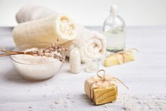 Homemade soap, dry lavender flowers and essential oil. Top view. Natural cosmetic oil, sea salt and handmade soap, towel on light background. Aromatherapy, spa royalty free stock photos
