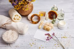 Homemade soap, dry lavender flowers and essential oil. Top view. Natural cosmetic oil, sea salt and handmade soap, towel on light background. Aromatherapy, spa stock images