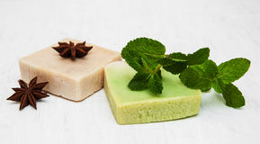 Homemade soap  with fresh mint leaves and anise. On a old white wooden background Stock Photography