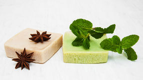 Homemade soap  with fresh mint leaves and anise. On a old white wooden background Stock Photo