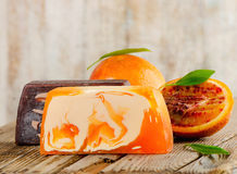 Homemade Soap. With fresh orange on a wooden table. Selective focus stock photo