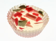 Homemade Soap. Piece of homemade soap, transparent, cast into a muffin mould, with pieces of colored soap in in stock images