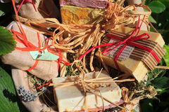 Homemade soaps. A lot of Homemade soaps inside a wicker basket Royalty Free Stock Photography