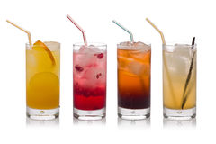 Homemade Sodas. Four glasses of cold, fresh, homemade sodas with ice and drinking straws against a white background. Flavors include orange, raspberry, cola and Stock Photos