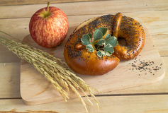 Homemade soft pretzels poppy seed on top and apply Royalty Free Stock Photos