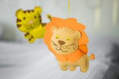 Homemade soft toys. Lion and Tiger. Background neutral shades. Stock Images