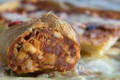 Homemade soppressata salami. Home made soppressata salami with variety of pizza Royalty Free Stock Photo