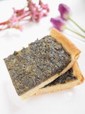 Homemade sorrel pie. On white plate with spring flowers Royalty Free Stock Photos