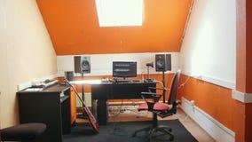 A homemade sound recording studio interior. Mid shot
