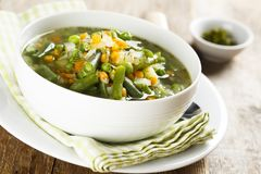 Homemade soup with fresh spring vegetables Royalty Free Stock Images