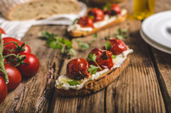 Homemade sourdough bread with roasted tomatoes Stock Images