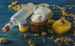 Homemade spa with natural ingredients of calendula and beeswax. Homemade spa on a wooden background royalty free stock photo