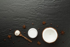 Homemade spa products. Half coconut shell, coffee and anise on b Royalty Free Stock Photography