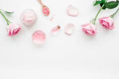 Homemade spa with rose cosmetic set, cream, salt and oil on white background top view mock-up Stock Images