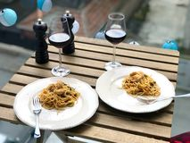 Homemade Spaghetti with Baby Spinach and Chicken at Dinner Table with Glass of Wine in Balcony. Traditional Organic Food stock images