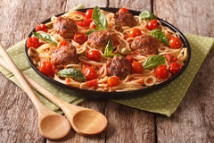 Homemade spaghetti with meatballs and tomato sauce closeup on a Stock Image