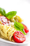 Homemade spaghetti pasta with avocado, tomato and basil sauce Stock Photos