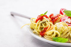 Homemade spaghetti pasta with avocado, tomato and basil sauce Royalty Free Stock Images