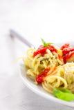 Homemade spaghetti pasta with avocado, tomato and basil sauce Royalty Free Stock Photography