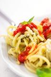 Homemade spaghetti pasta with avocado, tomato and basil sauce Stock Image