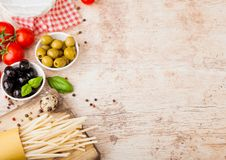 Homemade spaghetti pasta with quail eggs with bottle of tomato sauce and cheese on wooden background. Classic italian village food royalty free stock photos