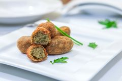 Homemade spanish tapa. Croquette with onion and spinach Royalty Free Stock Photography