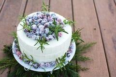 Homemade Sparkling Cranberry White Chocolate Cake. White chocolate cranberry cake decorated with sparkling sugar coated fresh cranberries, Holiday cake, Homemade Stock Image