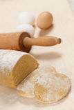 Homemade spelt dough for noodles on wooden table. Royalty Free Stock Photo
