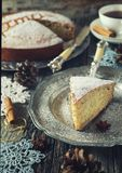 Homemade spiced Christmas cake, cup of tea and crocheted snowflakes. Toned image Stock Images