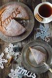 Homemade spiced Christmas sponge cake and cup of tea Stock Photo