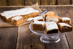 Homemade spiced pumpkin cake with cream cheese frosting stock photography