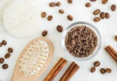 Homemade spicy aroma scrub with brown sugar, ground coffee, olive oil and cinnamon powder. DIY beauty treatments and spa recipe. Top view, copy space stock photography