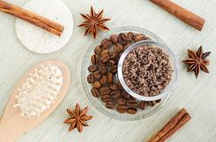Homemade spicy aroma scrub with brown sugar, ground coffee, olive oil, cinnamon and star anise powder.. DIY beauty treatments and spa recipe. Top view, copy royalty free stock photography