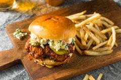 Homemade Spicy Nashville Hot Chicken Sandwich. With Ranch and Pickles royalty free stock photography
