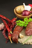 Homemade spicy pepper sausage. Homemade rustic sausages and chili. Sharp traditional food. Traditional butchers. Stock Image