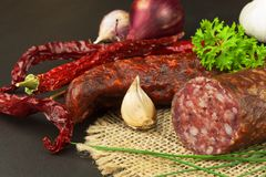 Homemade spicy pepper sausage. Homemade rustic sausages and chili. Sharp traditional food. Traditional butchers. Stock Photos