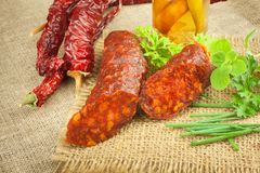 Homemade spicy pepper sausage. Homemade rustic sausages and chili. Sharp traditional food. Traditional butchers. Royalty Free Stock Photo