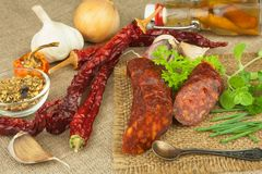 Homemade spicy pepper sausage. Homemade rustic sausages and chili. Sharp traditional food. Traditional butchers. Stock Photo