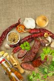 Homemade spicy pepper sausage. Homemade rustic sausages and chili. Sharp traditional food. Traditional butchers. Spicy delicacy. Advertising on butcher Royalty Free Stock Photography