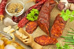 Homemade spicy pepper sausage. Homemade rustic sausages and chili. Sharp traditional food. Traditional butchers. Spicy delicacy. Advertising on butcher Royalty Free Stock Photos