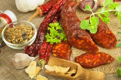 Homemade spicy pepper sausage. Homemade rustic sausages and chili. Sharp traditional food. Traditional butchers. Spicy delicacy. Advertising on butcher Royalty Free Stock Image