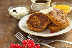 Homemade spicy pumpkin pancakes with honey and sour cream. Fritters Royalty Free Stock Photography