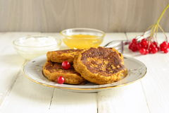 Homemade spicy pumpkin pancakes with honey and sour cream. Fritters Stock Images