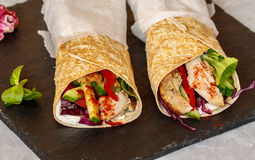 Homemade spicy tortilla wrap with a mix of ingredients. Chicken, vegetables and ricotta Royalty Free Stock Photos