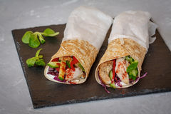 Homemade spicy tortilla wrap with a mix of ingredients. Chicken, vegetables and ricotta Stock Images