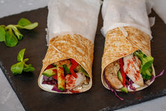 Homemade spicy tortilla wrap with a mix of ingredients. Chicken, vegetables and ricotta Royalty Free Stock Image