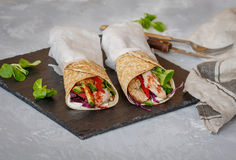Homemade spicy tortilla wrap with a mix of ingredients. Chicken, vegetables and ricotta Stock Photo