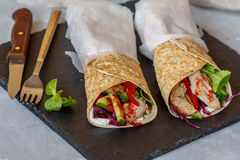 Homemade spicy tortilla wrap with a mix of ingredients. Chicken, vegetables and ricotta Royalty Free Stock Photography