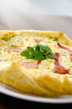 Homemade Spinach and Bacon Egg Quiche in a pie crust on wood board. French cuisine flat design Stock Photography