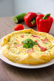 Homemade Spinach and Bacon Egg Quiche in a pie crust on wood board. French cuisine flat design Royalty Free Stock Image